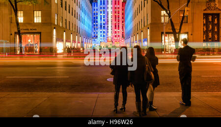 Rockefeller Center at twilight illuminated in red,white,and blue from 5th Avenue. Midtown Manhattan, New York City - Stock Photo