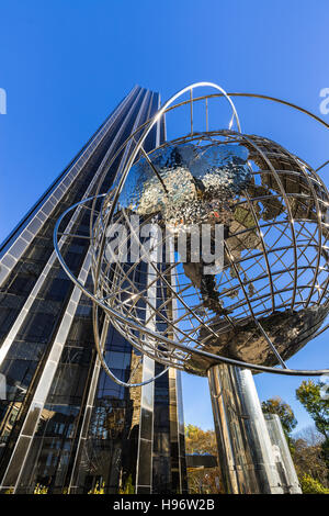 Trump International Hotel and Tower skyscraper with steel globe sculpture. Midtown, Manhattan, New York City - Stock Photo