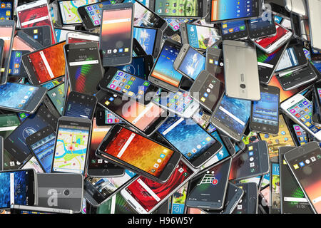 Choose mobile phone. Heap of the different smartphones with different application on the screen. Modern technology - Stock Photo