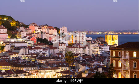 Cityscape of Lisbon, Portugal, seen from Miradouro Sao Pedro de Alcantara at night - Stock Photo
