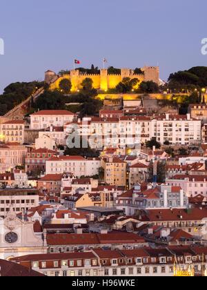 Cityscape of Lisbon, Portugal, with the Sao Jorge Castle seen from Miradouro Sao Pedro de Alcantara at night. - Stock Photo