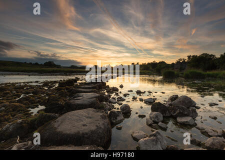 View of stepping stones across River Wharfe to Linton Church, Linton Falls, Wharfedale, Yorkshire Dales, UK - Stock Photo