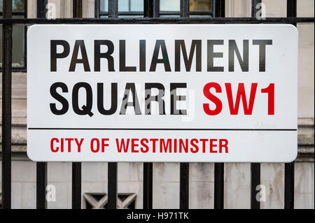 LONDON - NOVEMBER 16, 2016: Street sign for Parliament Square marks the open space between Westminster and the Supreme - Stock Photo