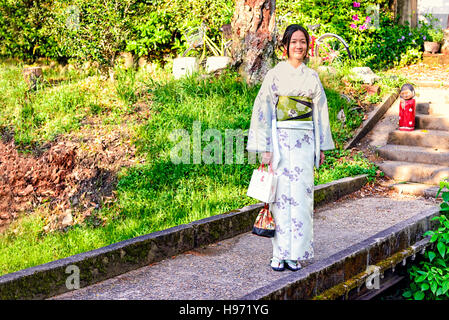 Kyoto, Japan - May 01, 2014: View of a Japanese girl wearing traditional Kimono. The kimono is a Japanese traditional - Stock Photo