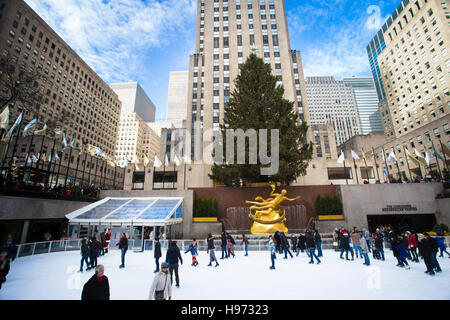 View from Rockefeller Center in Manhattan during the Christmas holiday season with skaters and Christmas tree. - Stock Photo