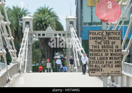 Vintage police notice sign on Cavenagh Bridge, Empress Place, Civic District, Singapore Island, Singapore - Stock Photo