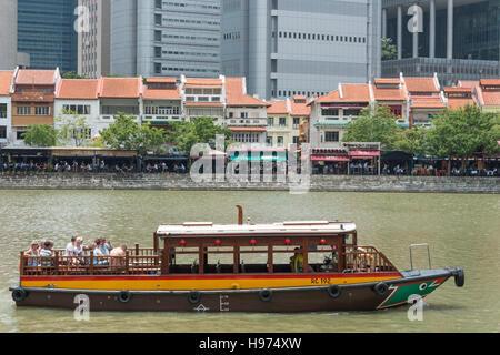 Ferry boat on Singapore River, Empress Place, Civic District, Singapore Island, Singapore - Stock Photo
