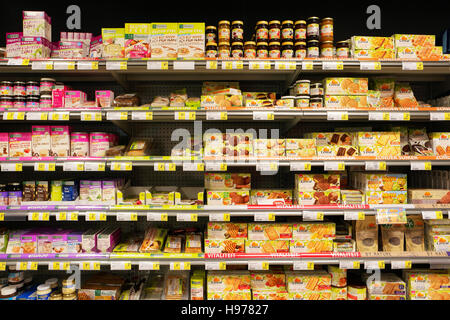 Shelves with various glutenfree products in a Supermarket - Stock Photo
