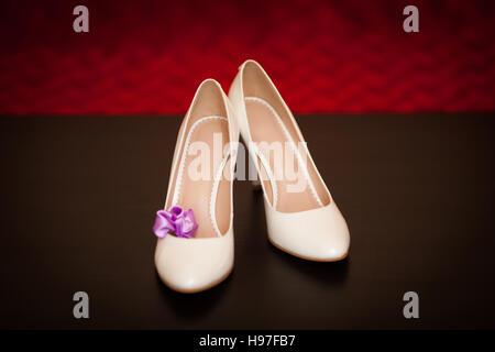 Elegant and stylish bridal shoes on dark background. Wedding concept - Stock Photo