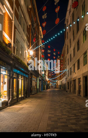 LONDON - NOVEMBER 19, 2016: Christmas lights on Carnaby Street, London UK. - Stock Photo