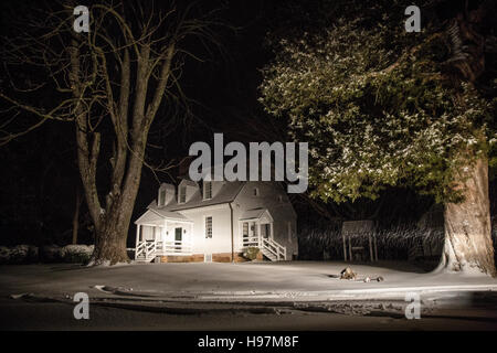 A plantation home at night in a snowstorm - Stock Photo