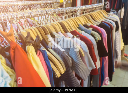 fashion clothing on hangers at the show. - Stock Photo