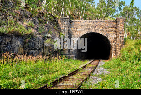 Facade of one of many tunnels on Circum-Baikal Railway. Architecture of early 20th century. Irkutsk region. Russia - Stock Photo
