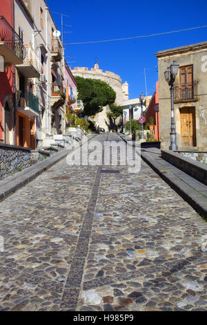 Road in historical centre of Milazzo town. Messina, Sicily - Stock Photo