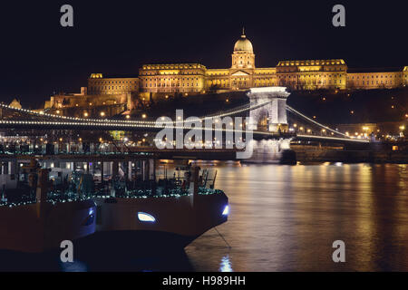 Night view at Royal Castle in Budapest. Chain bridge and river. - Stock Photo