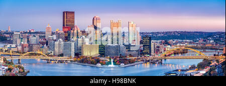 Pittsburgh, Pennsylvania skyline at dusk. Located at the confluence of the Allegheny, Monongahela and Ohio rivers - Stock Photo