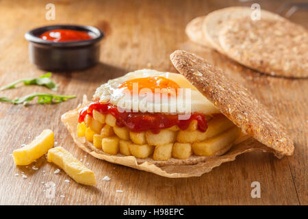 Chip Butty sandwich with potato chips or fries and ketchup - Stock Photo