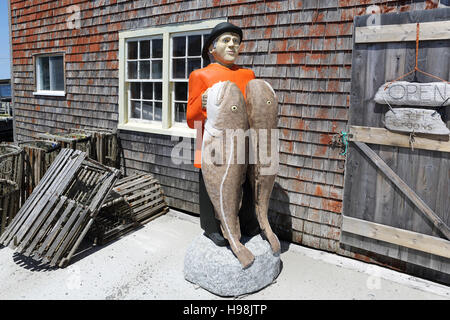 A figure shaped like a fisherman in the fishing village of Peggy's Cove in Nova Scotia, Canada. - Stock Photo