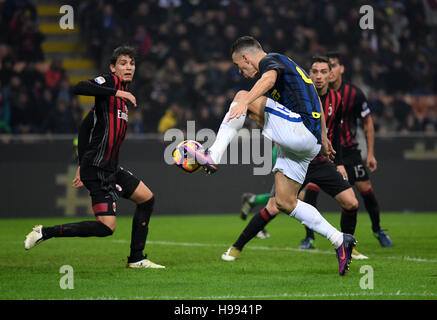 Milan. 20th Nov, 2016. Inter Milan's Ivan Perisic scores during the Italian Serie A football match between AC Milan - Stock Photo