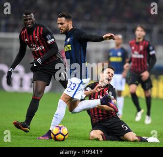 Milan. 20th Nov, 2016. Inter Milan's Danilo D'Ambrosio (C) vies with AC Milan's Giacomo Bonaventura (R) during the - Stock Photo
