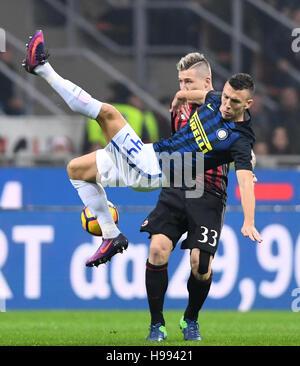 Milan. 20th Nov, 2016. Inter Milan's Ivan Perisic (Front) vies with AC Milan's Juraj Kucka during the Italian Serie - Stock Photo