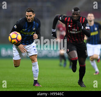 Milan. 20th Nov, 2016. Inter Milan's Danilo D'Ambrosio (L) chases the ball with AC Milan's M'Baye Niang during the - Stock Photo