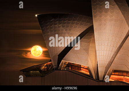 Sydney city landmarks around Circular quay on a super moon full moon night with rising earth satellite passing by - Stock Photo