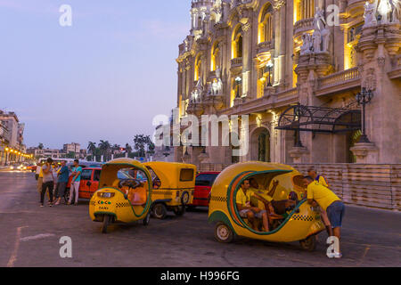 Havana, Cuba: Coco taxis people in Old Havana - Stock Photo