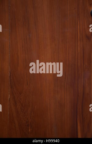 Texture of varnished brown mahogany wood with veins - Stock Photo