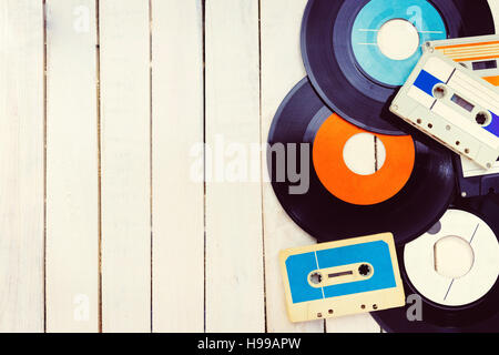 Top view of audio cassettes and gramophone records with negative space. - Stock Photo