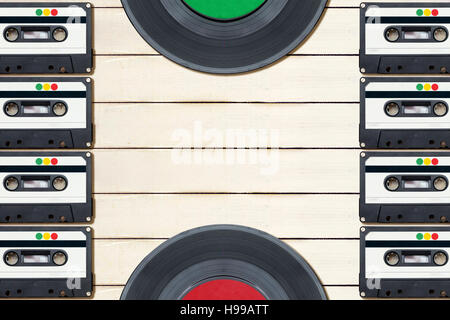 Top view of audio cassettes and gramophone records.With negative space between. - Stock Photo