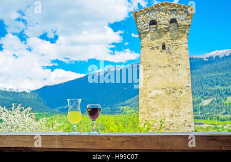 The open terrace with the view on Svan tower and huge mountain range is the best place to drink a glass of fantastic - Stock Photo