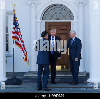 President elect Donald Trump and Vice President elect Mike Pence greet Mitt Romney at the clubhouse at Trump International Golf Club, November 19, 2016 in Bedminster Township, New Jersey. (Aude Guerrucci / Pool) *** Please Use Credit from Credit Field ***