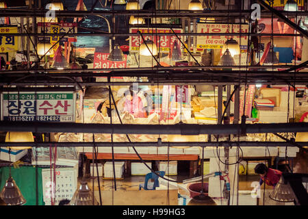 SEOUL - OCTOBER 23, 2016: View of shoppers at Noryangjin Fisheries Wholesale Market The 24 hour market has over - Stock Photo