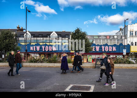 People walk past New York amusement arcade for playing games, pool, slot machines and betting. Southend-on-sea, - Stock Photo