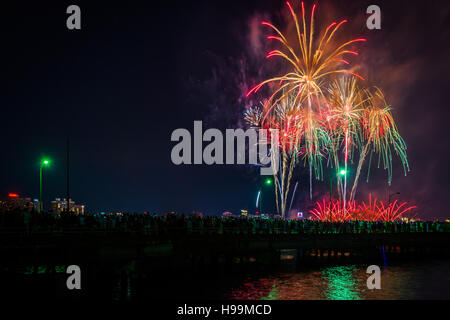 Fourth of July fireworks over the Broad Canal at night, in Cambridge, Massachusetts. - Stock Photo