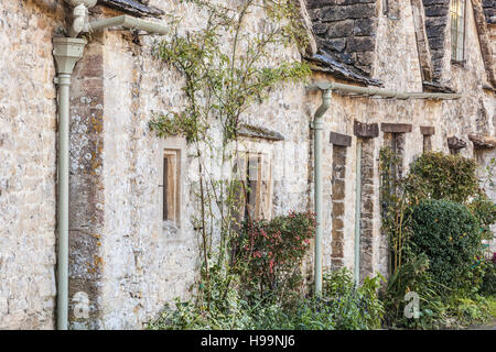 A close-up shot of the row of medieval houses at Arlington Row in Bibury which resides in the county of Gloucestershire. - Stock Photo