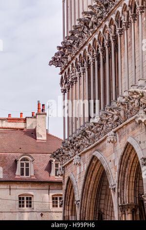 Gargoyles on the facade of Notre Dame de Dijon. - Stock Photo