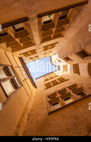 Looking up at the sky from one of the many traboules in Vieux Lyon. - Stock Photo