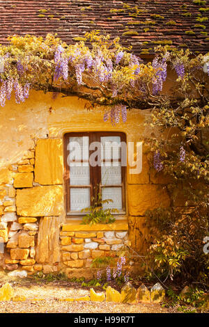 A typical stone cottage in the Dordogne area of France. - Stock Photo