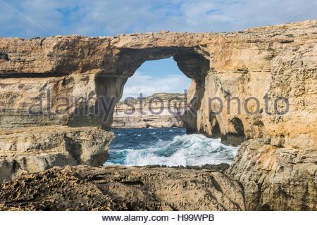 Famous stone arch known as The Azure Window at Dweja on Gozo, Malta. - Stock Photo