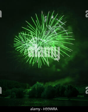 Beautiful green fireworks at night on the river in Moscow - Stock Photo