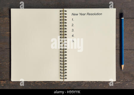 Business concept - Top view notebook writing New Year Resolution. - Stock Photo