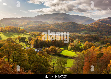 Elter Water with Coniston Mountain Range in distance Lake District Cumbria - Stock Photo