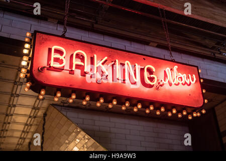 A retro sign saying 'Baking Now' - Stock Photo