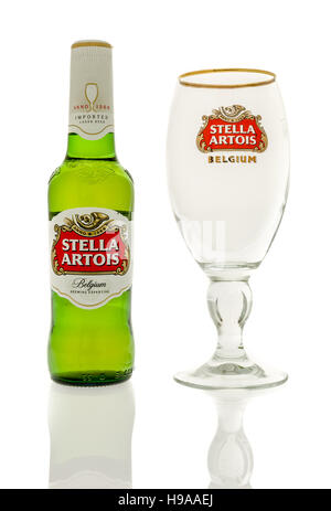 Winneconne, WI - 20 November 2016:  Bottle of Stella artois beer with an empty chalice on an isolated background. - Stock Photo