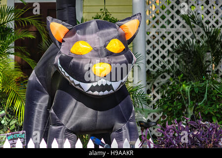 Inflatable Halloween Cat in a front yard on Duval Street, Key West, Florida - Stock Photo