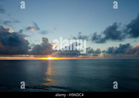Late afternoon sun shining through clouds, Anaiki, Niue, South Pacific, Oceania - Stock Photo