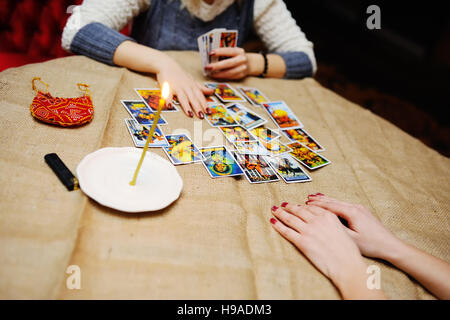 Divination by the Tarot cards. The fortune teller predicts the f - Stock Photo