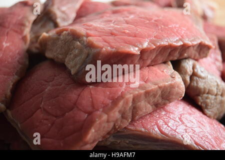 Close perspective succulent pieces of raw fillet steak - Stock Photo